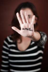 Woman with #MeToo written on hand.